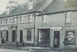 Houses and shops  on Montgomery Street, c 1900
